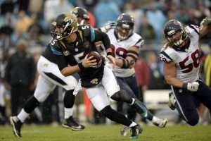 Blake Bortles (5) looks to escape pressure against the Texans last year.