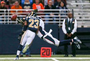 Rodney McLeod Jr, in what is so far his signature play, separates Broncos receiver Emmanuel Sanders from the ball in 2014.