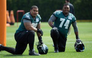 Eagles guard Brandon Brooks, chats with fellow offensive lineman Malcolm Bunche (74) before the start of practice.