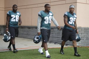 Rookie running backs Wendell Smallwood (28), Byron Marshall (39) and Cedric O'Neal (35) walk onto the field during OTA's.