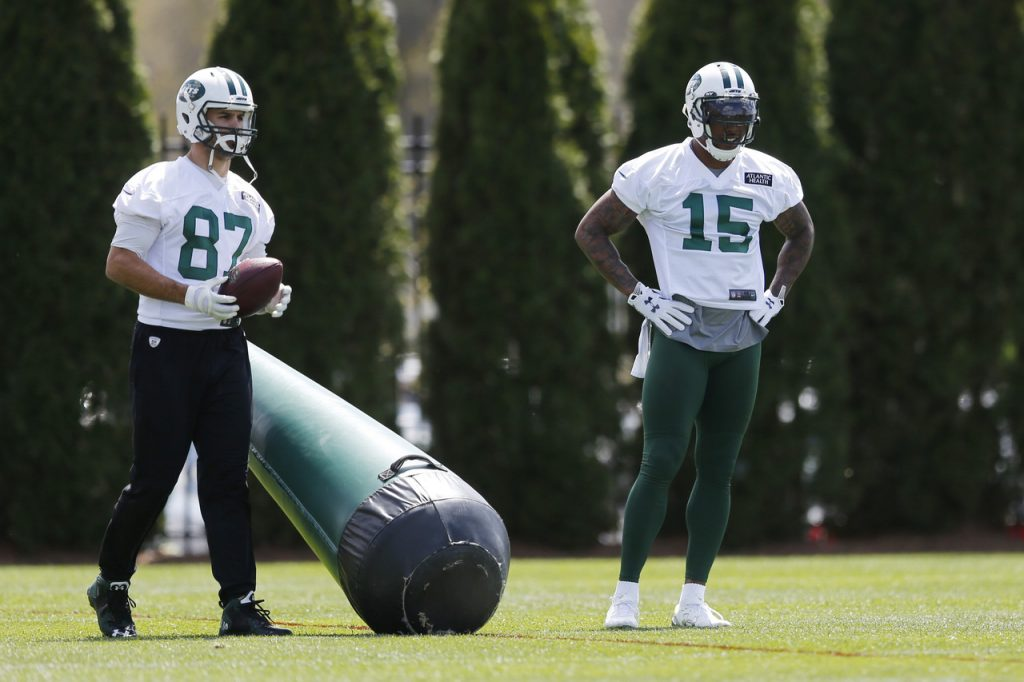 Eric Decker (87) and Brandon Marshall (15) take in drills earlier in training camp.