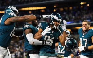 Eagles receiver Jordan Matthews is mobbed by teammates after scoring an overtime game winner in Dallas last year.