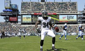 Aug 16, 2015; Philadelphia, PA, USA; Philadelphia Eagles running back Kenjon Barner (34) celebrates after scoring a 94-yard punt return touchdown during the second quarter against the Indianapolis Colts in a preseason NFL football game at Lincoln Financial Field. Mandatory Credit: Eric Hartline-USA TODAY Sports