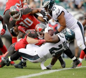 Eagles running back Ryan Mathews bounces off a tackle and lunges into the end zone during the Eagles preseason game versus the Tampa Bay Buccaneers.