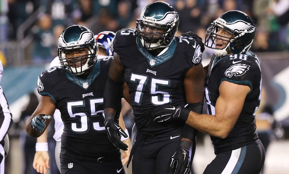 Oct 12, 2014; Philadelphia, PA, USA; Philadelphia Eagles linebacker Brandon Graham (55) and defensive end Vinny Curry (75) and linebacker Connor Barwin (98) celebrate a defensive stand during the first half at Lincoln Financial Field. The Eagles defeated the Giants 27-0. Mandatory Credit: Bill Streicher-USA TODAY Sports