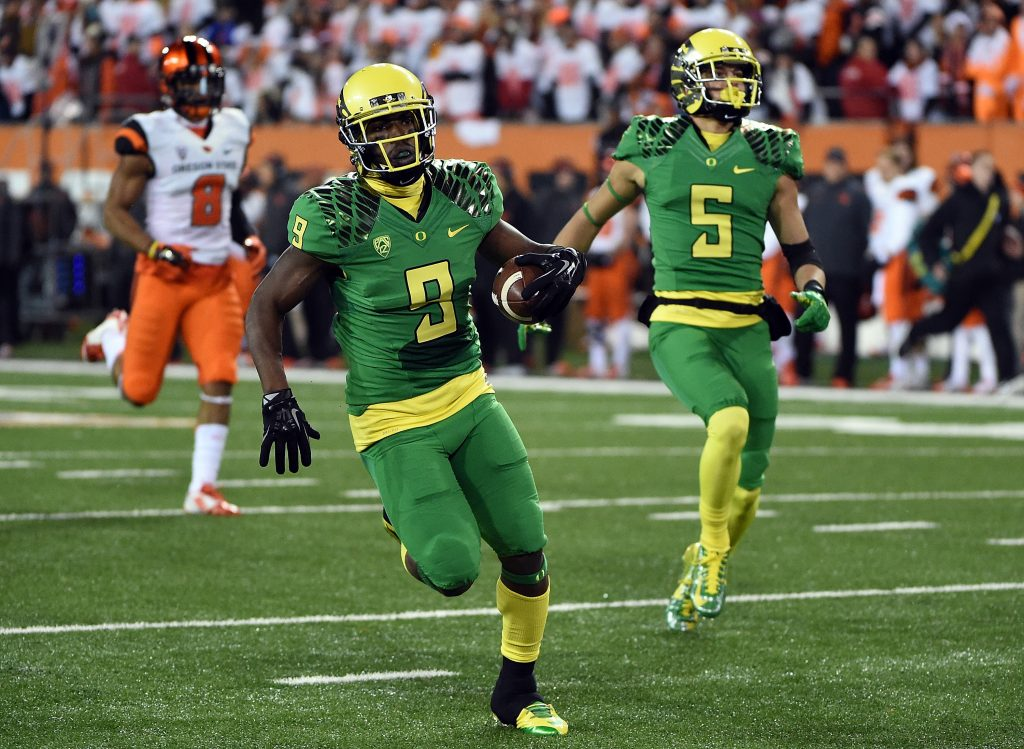 CORVALLIS, OR - NOVEMBER 29: Running back Byron Marshall #9 of the Oregon Ducks runs for a touchdown during the second quarter of the game at Reser Stadium on November 29, 2014 in Corvallis, Oregon.  (Photo by Steve Dykes/Getty Images)
