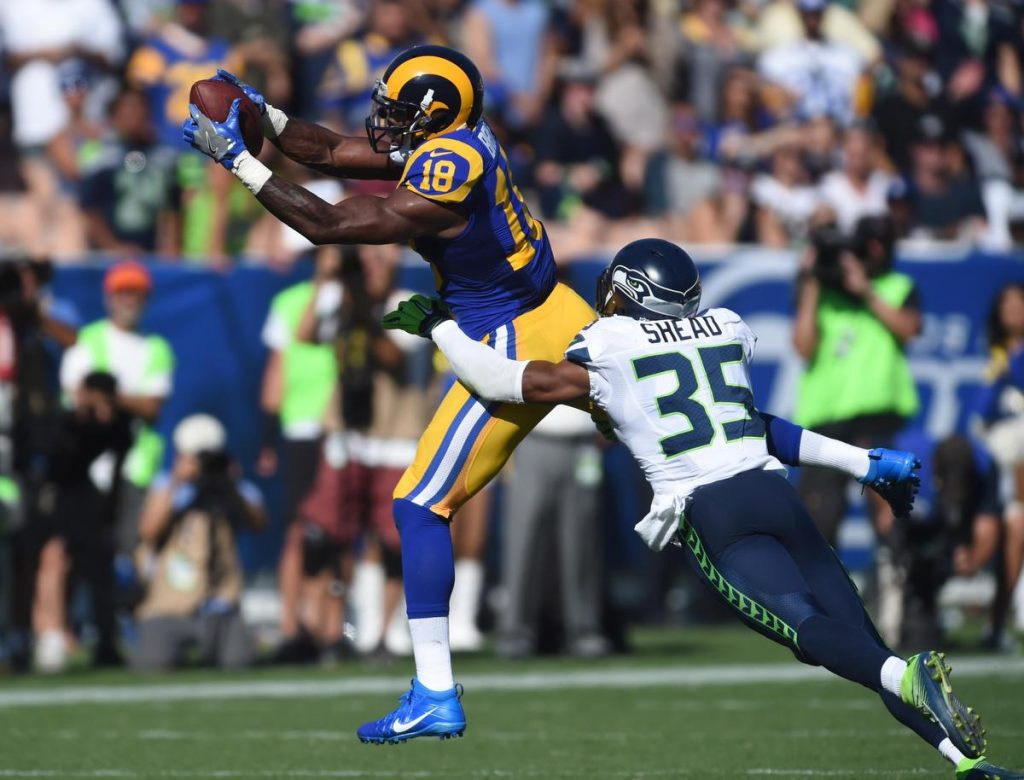 Los Angeles Rams Kenny Britt,18, makes catch for a first down against Seattle Seahawks defensive back DeShawn Shead,35, during the 4th quarter. The Rams won 9-3 in their home opener at the Los Angeles Coliseum.     Los Angeles Calif., Sunday, September ,18, 2016.            (Photo by Stephen Carr / Daily Breeze/ SCNG )