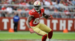 Torrey Smith looks to make a play up-field after making a catch for the San Francisco 49ers last year.