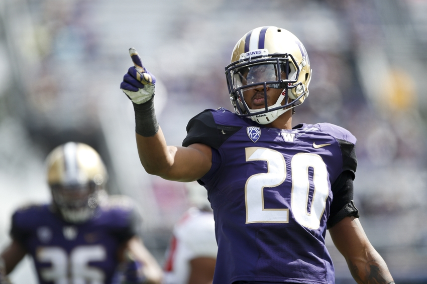 Sep 3, 2016; Seattle, WA, USA; Washington Huskies defensive back Kevin King (20) points to the stands after making a tackle for a loss against the Rutgers Scarlet Knights during the second quarter at Husky Stadium. Mandatory Credit: Jennifer Buchanan-USA TODAY Sports