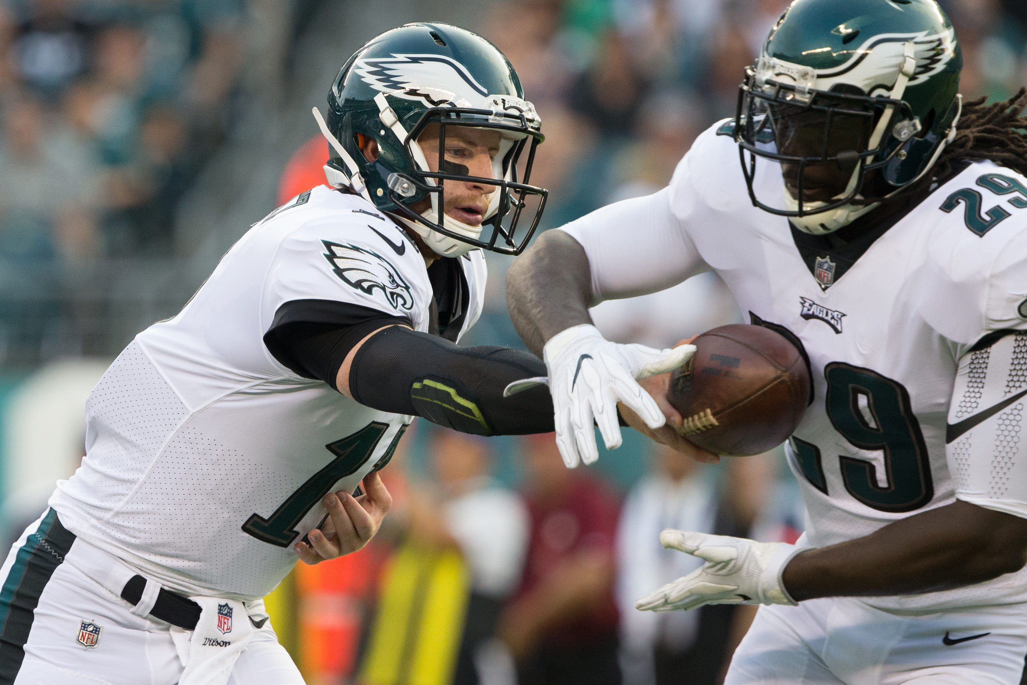 Aug 17, 2017; Philadelphia, PA, USA; Philadelphia Eagles quarterback Carson Wentz (11) hands off to running back LeGarrette Blount (29) against the Buffalo Bills during the first quarter at Lincoln Financial Field. Mandatory Credit: Bill Streicher-USA TODAY Sports