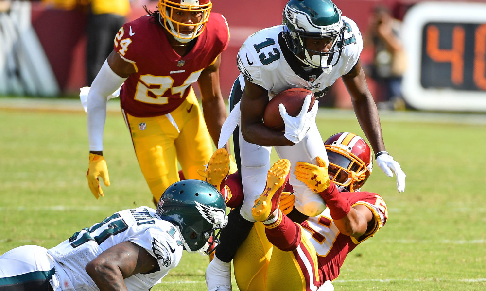 Sep 10, 2017; Landover, MD, USA; Philadelphia Eagles wide receiver Nelson Agholor (13) is tackled by Washington Redskins cornerback Kendall Fuller (29) during the second half at FedEx Field. Mandatory Credit: Brad Mills-USA TODAY Sports