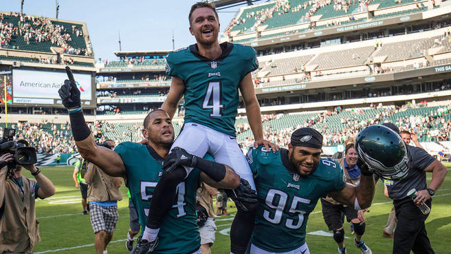 Sep 24, 2017; Philadelphia, PA, USA; Philadelphia Eagles kicker Jake Elliott (4) is carried off the field by outside linebacker Kamu Grugier-Hill (54) and outside linebacker Mychal Kendricks (95) after kicking a game winning 61 yard field goal as time expires for a victory against the New York Giants during the fourth quarter at Lincoln Financial Field. Mandatory Credit: Bill Streicher-USA TODAY Sports
