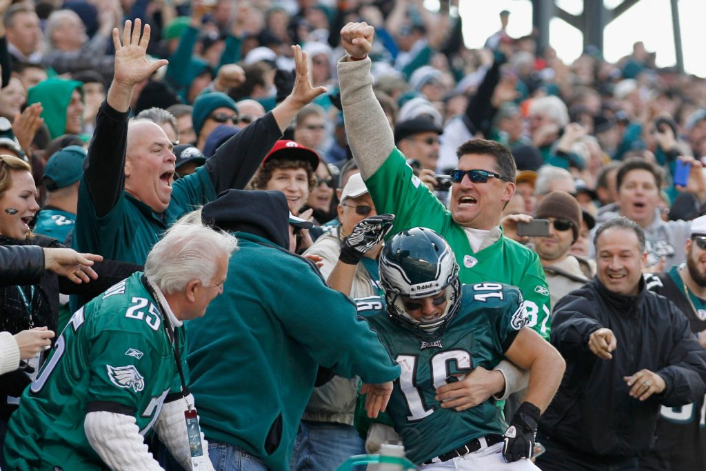 PHILADELPHIA, PA - JANUARY 01:   Chad Hall #16 of the Philadelphia Eagles celebrates with fans after catching a touchdown pass during the first half against the Washington Redskins at Lincoln Financial Field on January 1, 2012 in Philadelphia, Pennsylvania.  (Photo by Rob Carr/Getty Images)