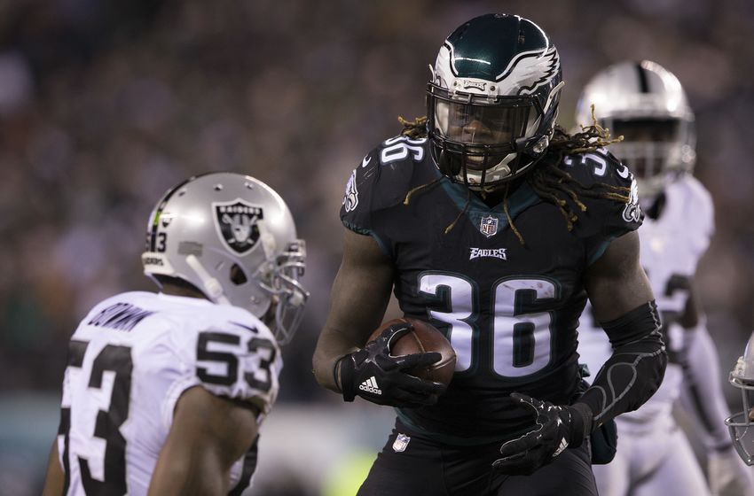 PHILADELPHIA, PA - DECEMBER 25: Jay Ajayi #36 of the Philadelphia Eagles reacts in front of NaVorro Bowman #53 of the Oakland Raiders in the first quarter at Lincoln Financial Field on December 25, 2017 in Philadelphia, Pennsylvania. (Photo by Mitchell Leff/Getty Images)