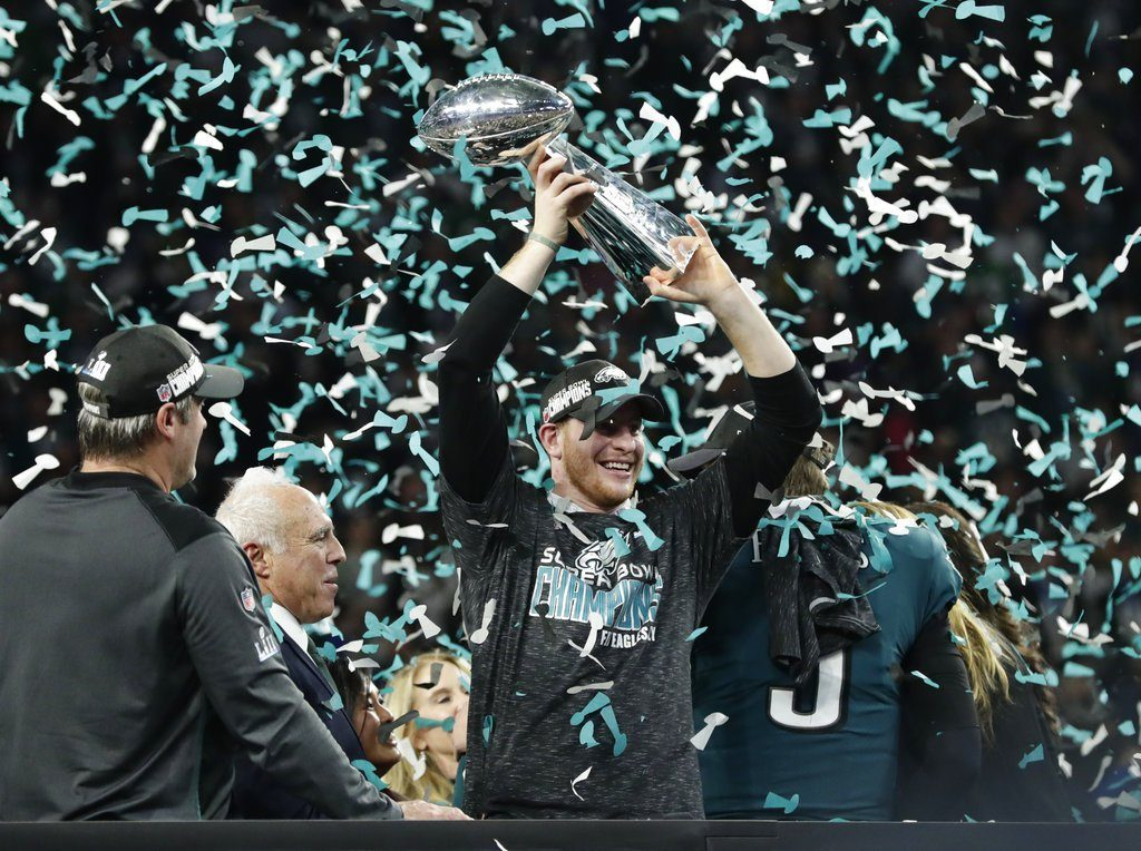 Philadelphia Eagles quarterback Carson Wentz hoists the Vincent Lombardi trophy after the NFL Super Bowl 52 football game against the New England Patriots, Sunday, Feb. 4, 2018, in Minneapolis. The Eagles won 41-33. (AP Photo/Frank Franklin II)