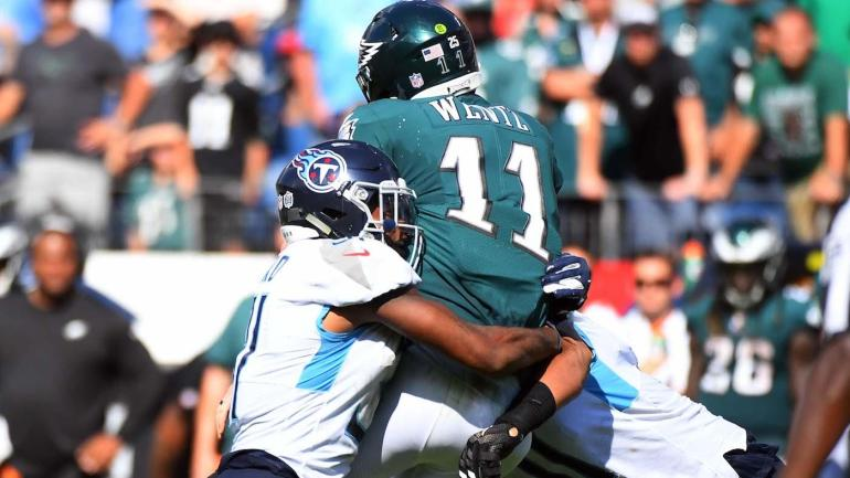 Sep 30, 2018; Nashville, TN, USA; Philadelphia Eagles quarterback Carson Wentz (11) is hit by Tennessee Titans defensive back Kevin Byard (31) and linebacker Derrick Morgan (91) during the second half at Nissan Stadium. Mandatory Credit: Christopher Hanewinckel-USA TODAY Sports