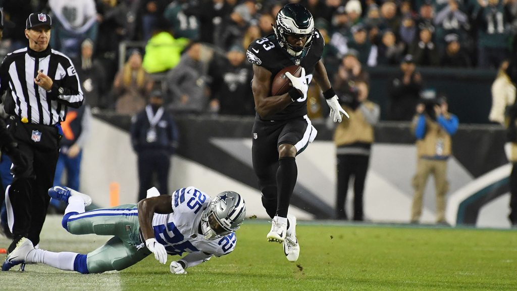 Nov 11, 2018; Philadelphia, PA, USA; Philadelphia Eagles running back Josh Adams (33) carries the ball in the second quarter as Dallas Cowboys safety Xavier Woods (25) defends at Lincoln Financial Field. Mandatory Credit: James Lang-USA TODAY Sports