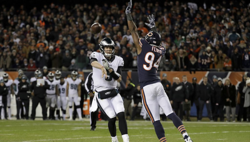 Philadelphia Eagles quarterback Nick Foles (9) throws a touchdown pass against Chicago Bears outside linebacker Leonard Floyd (94) during the second half of an NFL wild-card playoff football game Sunday, Jan. 6, 2019, in Chicago. (AP Photo/Nam Y. Huh)