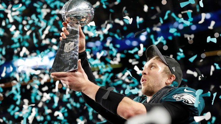 NFL Football - Philadelphia Eagles v New England Patriots - Super Bowl LII - U.S. Bank Stadium, Minneapolis, Minnesota, U.S. - February 4, 2018  Philadelphia Eagles' Nick Foles celebrates with the Vince Lombardi Trophy after winning Super Bowl LII  REUTERS/Kevin Lamarque - RC1B4BB6C600