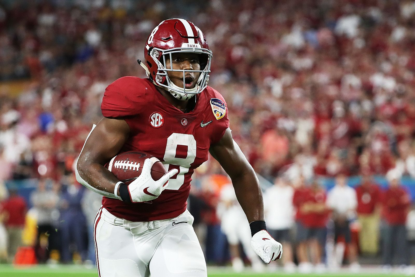 MIAMI, FL - DECEMBER 29:  Josh Jacobs #8 of the Alabama Crimson Tide carries the ball in the second quarter during the College Football Playoff Semifinal against the Oklahoma Sooners at the Capital One Orange Bowl at Hard Rock Stadium on December 29, 2018 in Miami, Florida.  (Photo by Streeter Lecka/Getty Images)