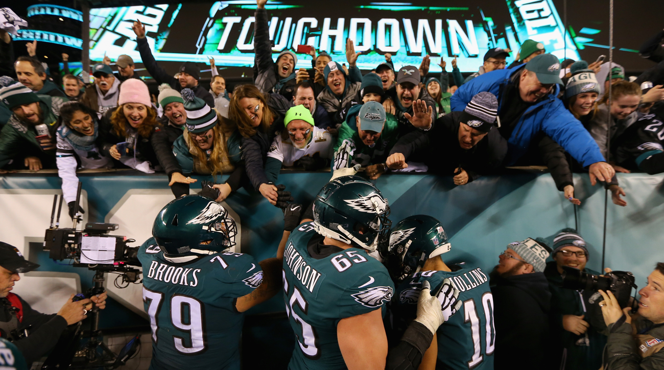 PHILADELPHIA, PA - JANUARY 21:Brandon Brooks #79, Lane Johnson #65 and Mack Hollins #10 of the Philadelphia Eagles celebrate with the fans after a fourth quarter touchdown against the Minnesota Vikings in the NFC Championship game at Lincoln Financial Field on January 21, 2018 in Philadelphia, Pennsylvania.  (Photo by Mitchell Leff/Getty Images)
