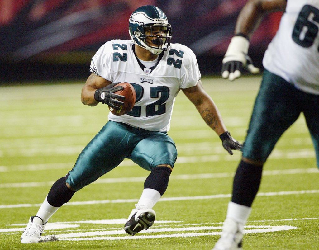 ATLANTA - NOVEMBER 2:  Running back Duce Staley #22 of the Philadelphia Eagles carries the ball against the Atlanta Falcons during the game at the Georgia Dome on November 2, 2003 in Atlanta, Georgia. The Eagles defeated the Falcons 23-16. (Photo by Jamie Squire/Getty Images)