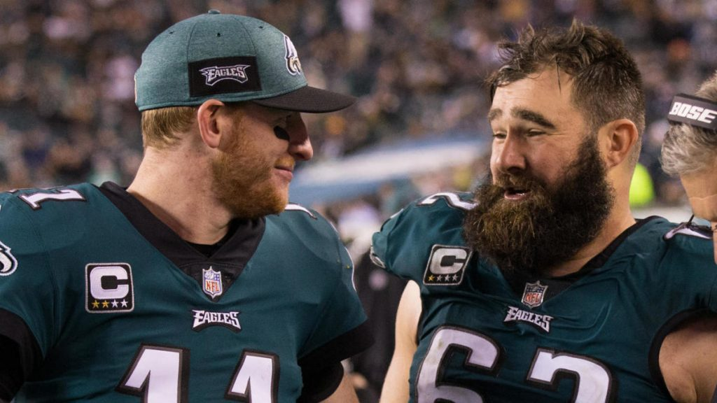 Dec 3, 2018; Philadelphia, PA, USA; Philadelphia Eagles quarterback Carson Wentz (11) and center Jason Kelce (62) talk on the sideline during the fourth quarter against the Washington Redskins at Lincoln Financial Field. Mandatory Credit: Bill Streicher-USA TODAY Sports