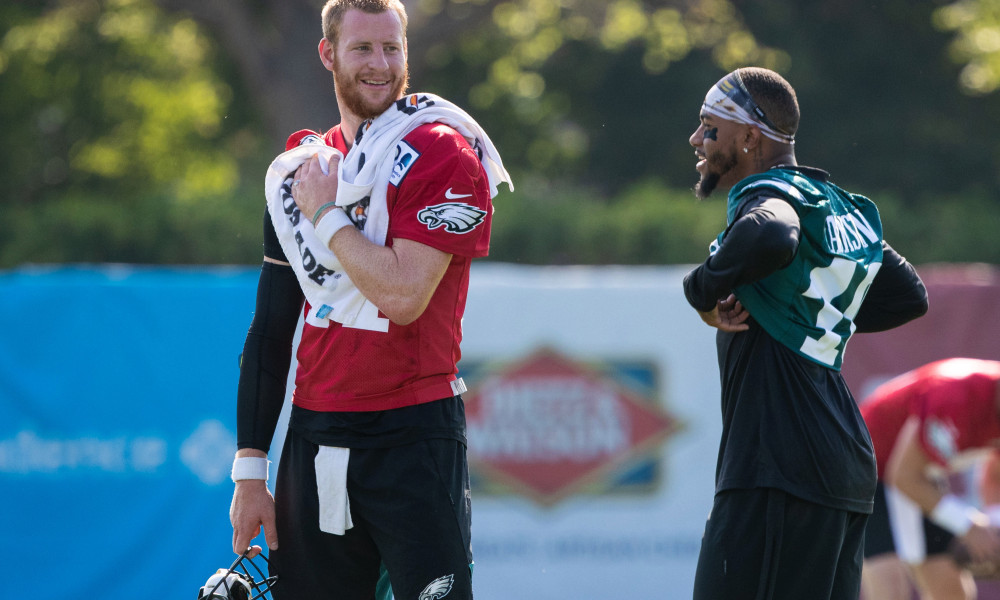 Jul 26, 2019; Philadelphia, PA, USA; Philadelphia Eagles quarterback Carson Wentz (11) and wide receiver DeSean Jackson (10) talks during training camp at Novacare Complex. Mandatory Credit: Bill Streicher-USA TODAY Sports