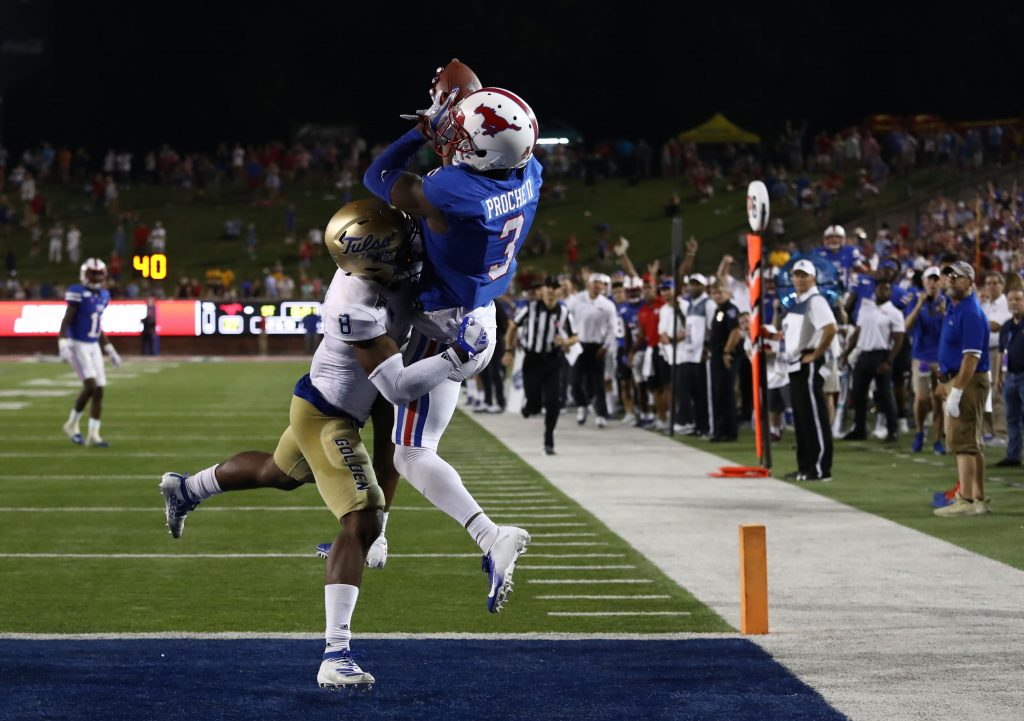 DALLAS, TEXAS - OCTOBER 05:  James Proche #3 of the Southern Methodist Mustangs makes the game winning touchdown pass against Brandon Johnson #8 of the Tulsa Golden Hurricane in overtime at Gerald J. Ford Stadium on October 05, 2019 in Dallas, Texas.  (Photo by Ronald Martinez/Getty Images)