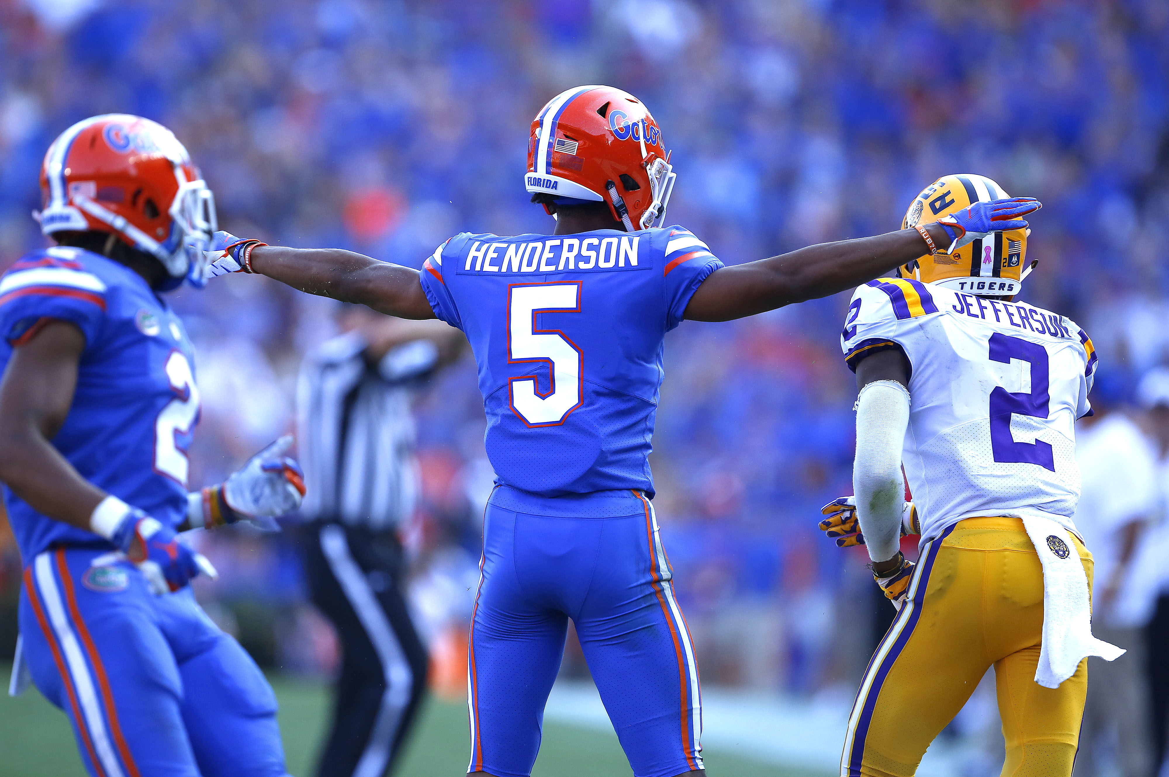 "Florida Gators defensive back CJ Henderson (5) gestures ""incomplete"" after defending a pass during a game against LSU at Ben Hill Griffin Stadium.  [Brad McClenny/ The Gainesville Sun]"