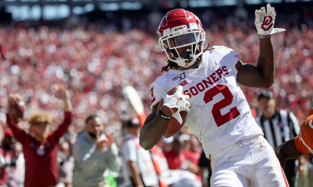 Oct 12, 2019; Dallas, TX, USA; Oklahoma Sooners wide receiver CeeDee Lamb (2) scores a touchdown during the second half against the Texas Longhorns at the Cotton Bowl. Mandatory Credit: Kevin Jairaj-USA TODAY Sports