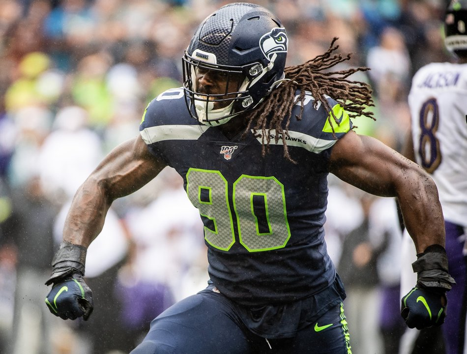 Seattle Seahawks outside linebacker Jadeveon Clowney (90) celebrates a tackle during the first quarter. The Seattle Seahawks played the Baltimore Ravens in a NFL football game at CenturyLink Field in Seattle, Wash., on Sunday, Oct. 20, 2019.
