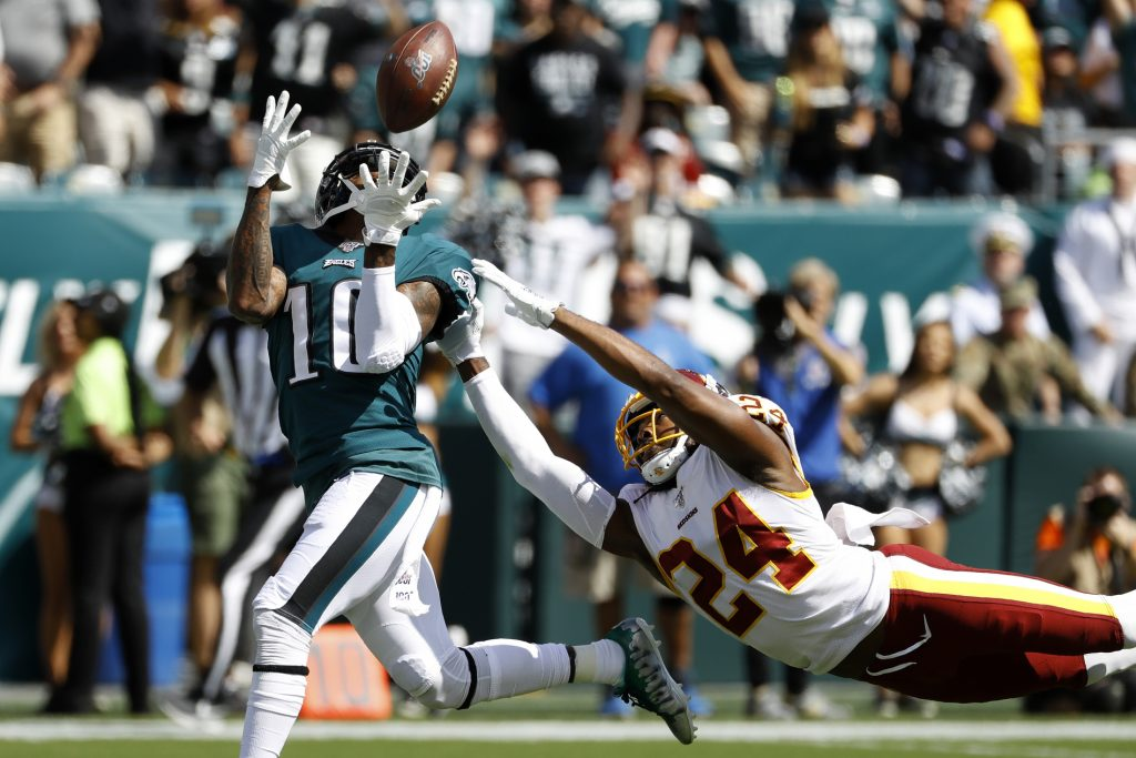 Philadelphia Eagles' DeSean Jackson, left, catches a touchdown pass against Washington Redskins' Josh Norman during the first half of an NFL football game, Sunday, Sept. 8, 2019, in Philadelphia. (AP Photo/Michael Perez)