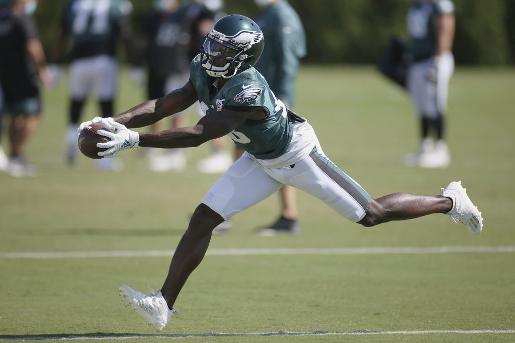 Philadelphia Eagles wide receiver Jalen Reagor (18) makes a catch during NFL football training camp at the team's practice facility, Wednesday, Aug. 26, 2020, in Philadelphia. (Tim Tai/The Philadelphia Inquirer via AP, Pool)