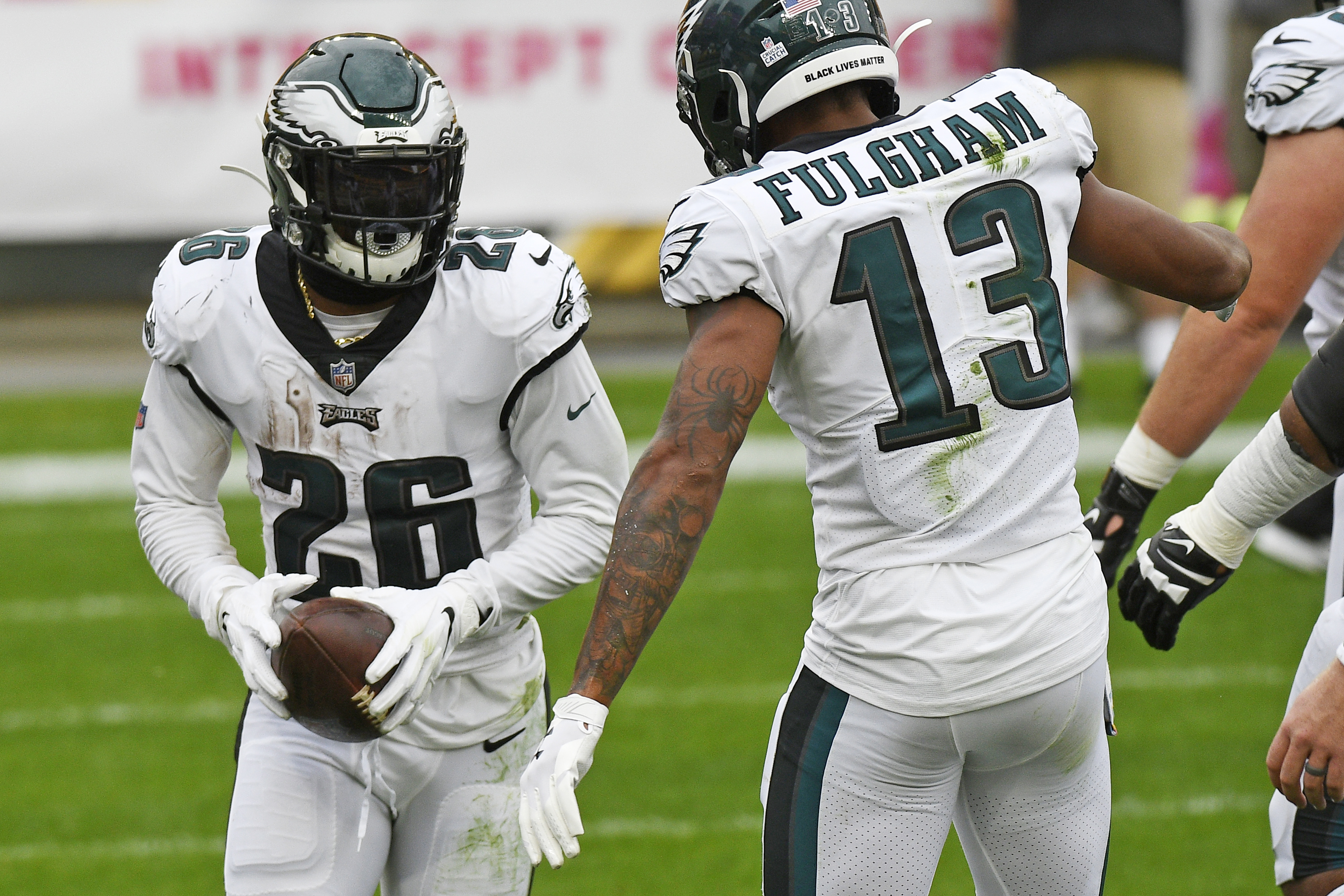 Philadelphia Eagles running back Miles Sanders (26) celebrates his touchdown with Travis Fulgham(13) during the first half of an NFL football game against the Pittsburgh Steelers in Pittsburgh, Sunday, Oct. 11, 2020. (AP Photo/Don Wright)
